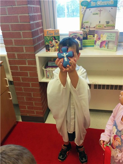 FDK child pretends to be a Priest during play