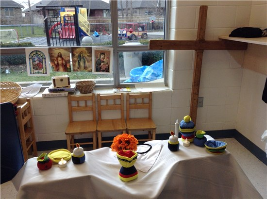 FDK students use a toy Mass Kit to create an altar for use in play