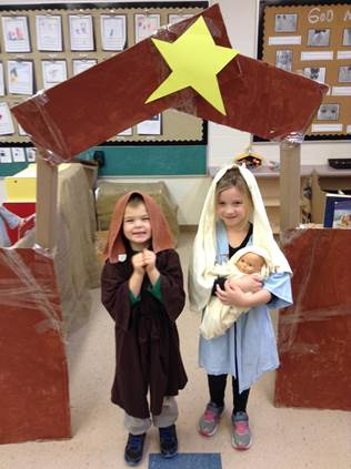 FDK children recreating the Nativity in front of the class made stable