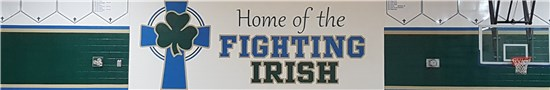 "The banner on the gymnasium wall reads ""Home of the Fighting Irish"""