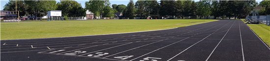 An image of UCC's track. Eight lanes move away from the camera down the straight 100-meter stretch.